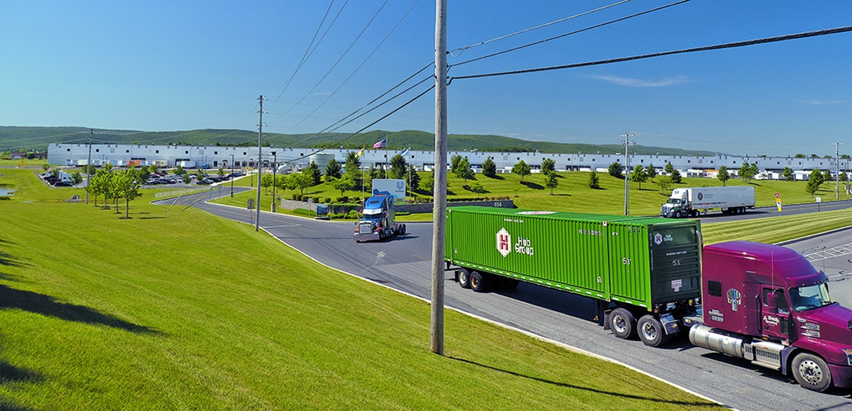 Trucks leave warehouses at the Key Logistics Park along Interstate 81 near Carlisle, PA. (Bay Journal photo by Dave Harp)
