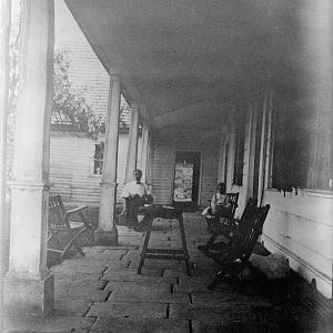 Looking south along front portico. (c. 1910)