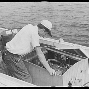 Waterman checking motor before leaving for home. Rock Point, Md 1941