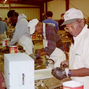 Professional shuckers preparing oysters for sale to the public